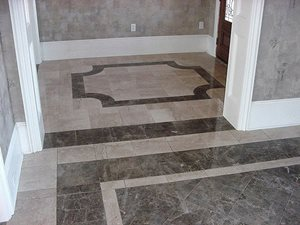 Breccia Paradiso and Diano Realle 12 x 12 marble set together make up this elegant foyer and dining room combination in a residence located in Lakeshore Estates, Slidell LA.