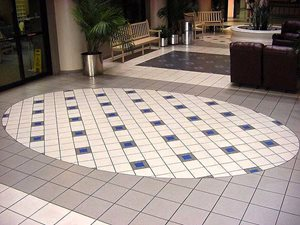 The lobby floor of Slidell Memorial Hospital was completed by Tymeless Flooring in December of 1992. The tile consisted of 12 x 12 porcelian set parallel with the builing lines. Two eliptical and three rectangle shapes were created with 8 x 8 porcela