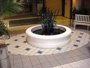Center Fountain lined with American Olean 2 x 2 Satin Brites.