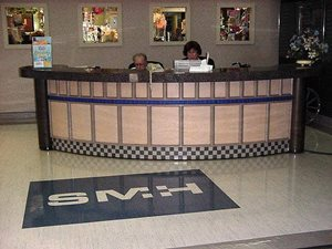 SMH Reception Desk with tile from the floor cut down to make a custom accent band.