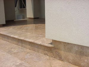 12 x 12 Honed Mexican Travertine (Noche) with 3cm bullnose coping was used to finish the entry court yard at a residence in the Inlets, a gated community outside of Slidell Louisiana.