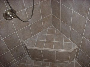 American Olean Calliano 6 x 6 wall tile, color Noce, with matching 1 x 6 quarter round trim as a three side corner seat.