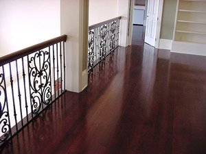Columbia Revere Black Cherry wood flooring is used on the balcony overlooking the great room.