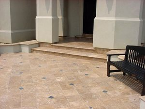 12 x 12 Honed Mexican Travertine (Noche) with 3cm bullnose coping along with 4 x 4 Black Slate accent tile set with a 1/16 grout joint was used to finish the entry court yard at a residence in the Inlets, a gated community outside of Slidell Louisian